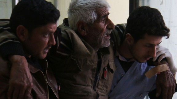 A Syrian man reacts as he receives treatment at a makeshift hospital following reported air strikes in the city of Azaz, on Syria's northern border with Turkey, on February 15, 2016.