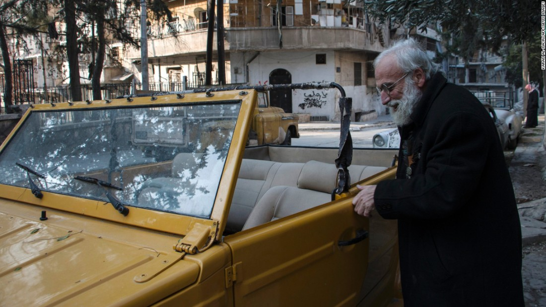 Omar inspects one of his cars in the al-Shaar district of Aleppo.