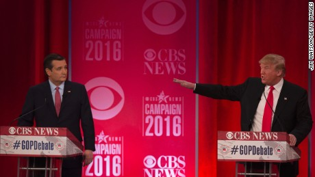 Republican presidential candidate Donald Trump (R) gestures towards  Ted Cruz (L) during the CBS News Republican Presidential Debate in Greenville, South Carolina, February 13, 2016.  / AFP / JIM WATSON        (Photo credit should read JIM WATSON/AFP/Getty Images)