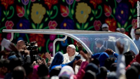 Pope Francis waves to the crowd in San Cristobal de las Casas, Mexico, Monday, February 15, where he will preside over a Mass.