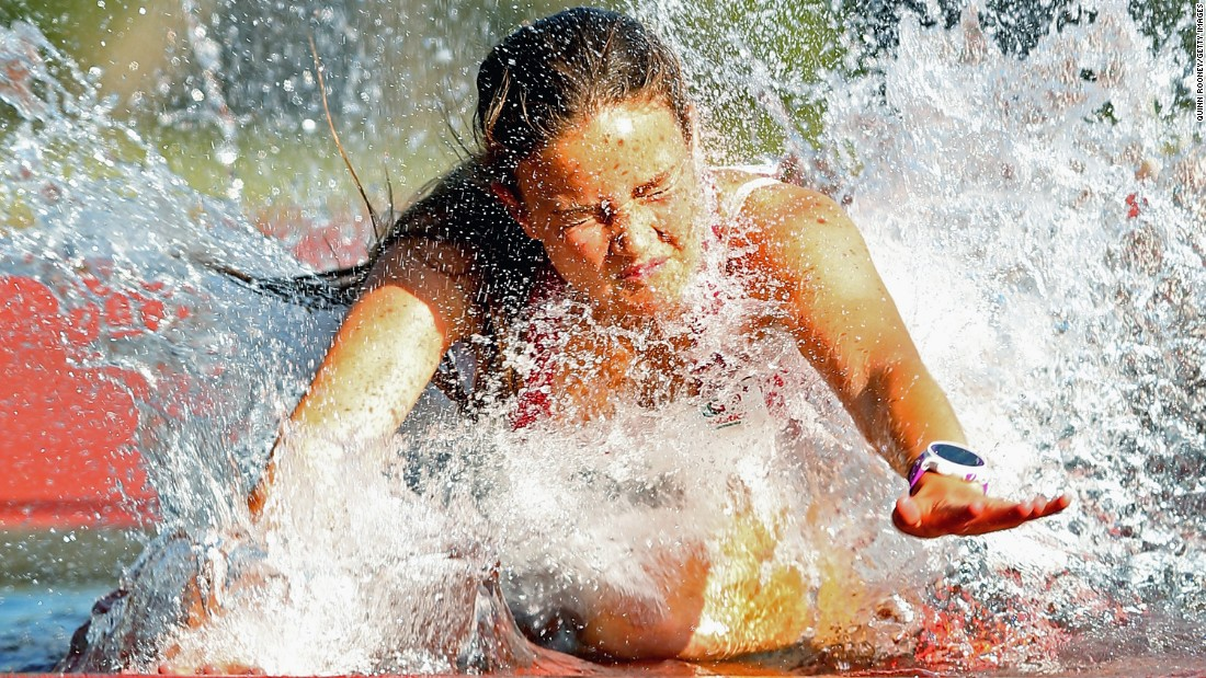 Tasmania's Ebony Webb trips into the water Saturday, February 13, during a steeplechase race at the Briggs Athletic Classic in Hobert, Australia.