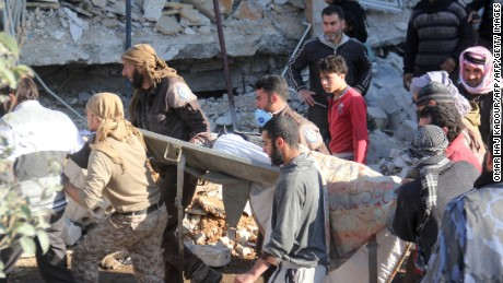 A victim is carried on a stretcher after the strike on the hospital in Maarat al-Numan, Idlib province.