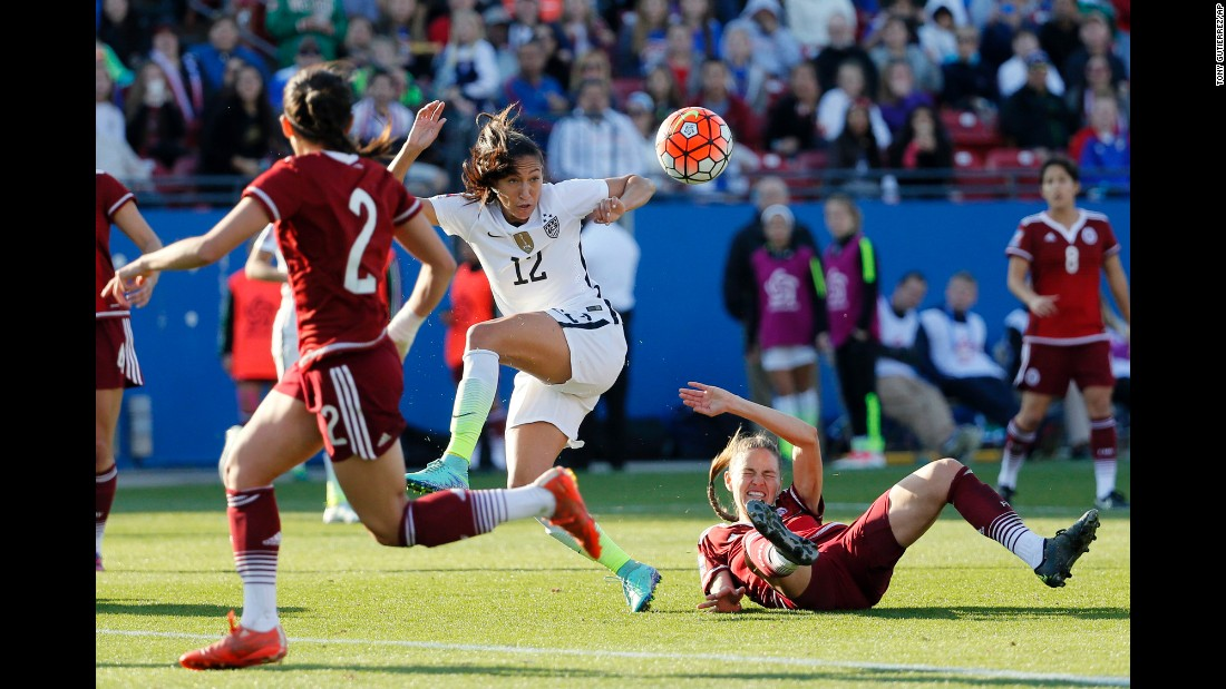 U.S. forward Christen Press, center, loses control of the ball as she's defended by Mexico's Ganelly Farias, right, during an Olympic qualifier in Frisco, Texas, on Saturday, February 13. The United States won 1-0.