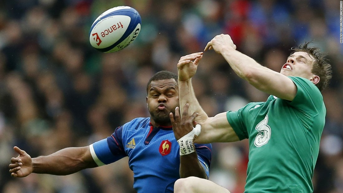 France's Virimi Vakatawa, left, competes with Ireland's Andrew Trimble during a Six Nations match in St. Denis, France, on Saturday, February 13.