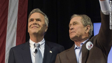 Former US President George W. Bush (R) waves with his wife Laura (L) as he stands with his brother and Republican presidential candidate Jeb Bush during a campaign rally in Charleston, South Carolina, February 15, 2016.