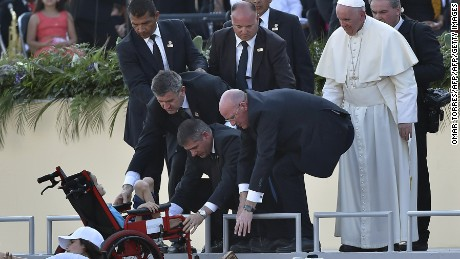 Pope Francis looks on after blessing a child on a wheelchair at the Victor Manuel Reyna stadium in Tuxtla Gutierrez, Chiapas state, Mexico on February 15, 2016.  Pope Francis reached out to Mexico's long-marginalized indigenous population on Monday, asking for forgiveness over their exclusion as he celebrated an open-air mass in native languages in impoverished Chiapas state. AFP PHOTO/OMAR TORRES / AFP / OMAR TORRES        (Photo credit should read OMAR TORRES/AFP/Getty Images)