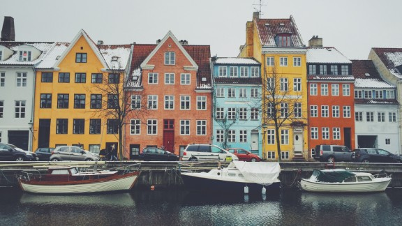 Houses stretch along a canal in Copenhagen