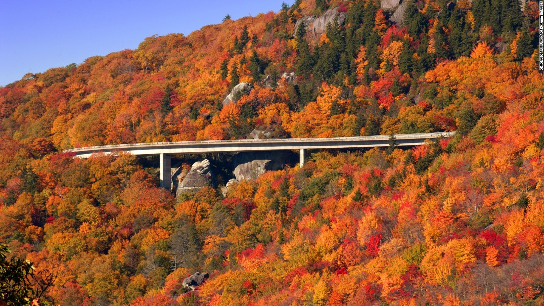 "The Blue Ridge Parkway tops  <a href=""http://www.cnn.com/specials/travel/nps-100"">National Park Service</a>'s list of most-visited sites in 2015, drawing more than 15 million visits. Fall foliage on the parkway's Linn Cove Viaduct in North Carolina is shown here. Click through the gallery to see the nine other most popular sites."