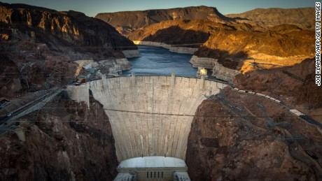 This April 13, 2014 view shows Hoover Dam, a concrete arch-gravity dam in the Black Canyon of the Colorado River on the border between the US states of Arizona and Nevada. Hoover Dam ,finished in 1936, impounds Lake Mead, the largest reservoir in the United States by volume. The dam's generators provide power for public and private utilities in Nevada, Arizona, and California. Hoover Dam is a major tourist attraction; nearly a million people tour the dam each year. AFP PHOTO/JOE KLAMAR        (Photo credit should read JOE KLAMAR/AFP/Getty Images)
