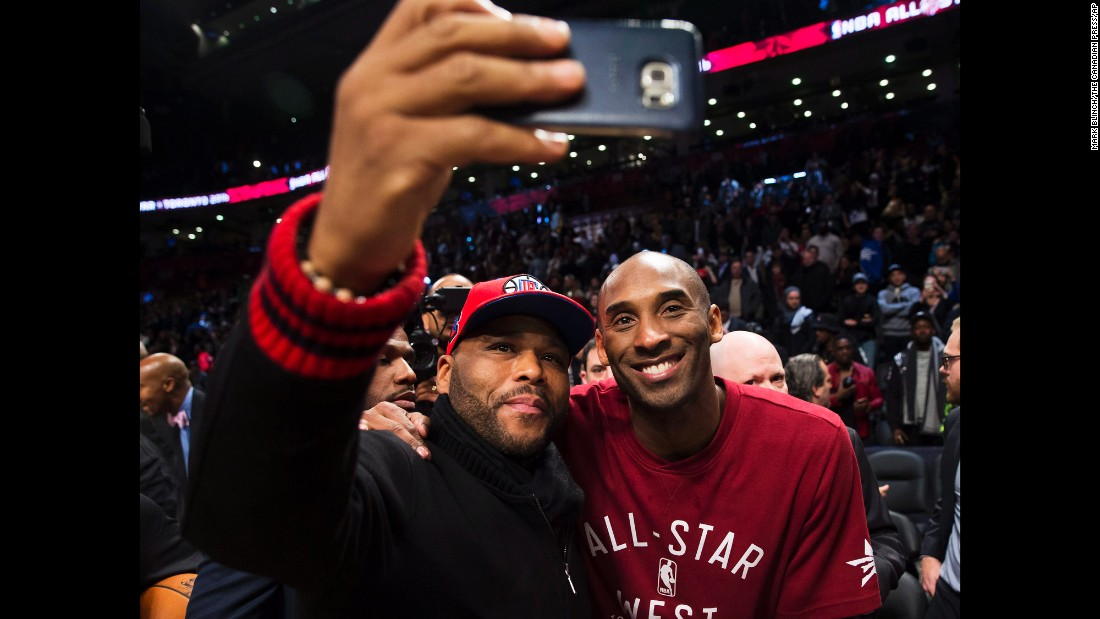 Actor Anthony Anderson snaps a selfie with basketball player Kobe Bryant during the NBA All-Star Game on Sunday, February 14.