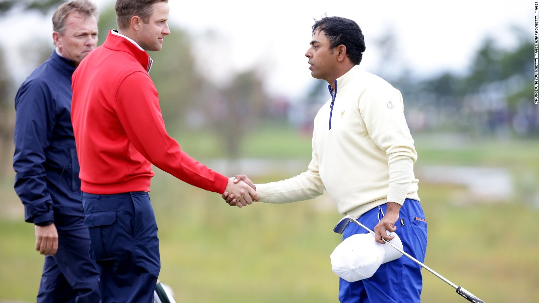Lahiri, seen here shaking hands with Chris Kirk of the U.S. team, says participating in tournaments like the Presidents Cup in October, 2015 is a sign that his career is going in the right direction.