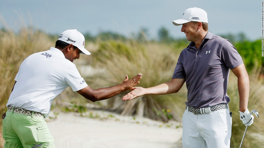 "The 28-year-old Lahiri says brushing shoulders with Tiger Woods in 2014 was ""surreal,"" but now counts some of the top players in the world as friends. Here he's seen celebrating with world No. 1 Jordan Spieth after the Texan shot a hole-in-one at a tournament in Bahamas on December 3, 2015."