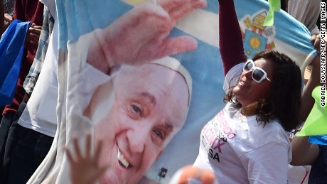 People cheer as Pope Francis arrives for a meeting with young people at the Jose Maria Morelos y Pavon stadium  in Morelia on February 16, 2016. Pope Francis urged Mexican priests and nuns on Tuesday to not despair in the face of violence as he visited a former bastion of a cult-like drug cartel.  AFP PHOTO / GABRIEL BOUYS / AFP / GABRIEL BOUYS        (Photo credit should read GABRIEL BOUYS/AFP/Getty Images)