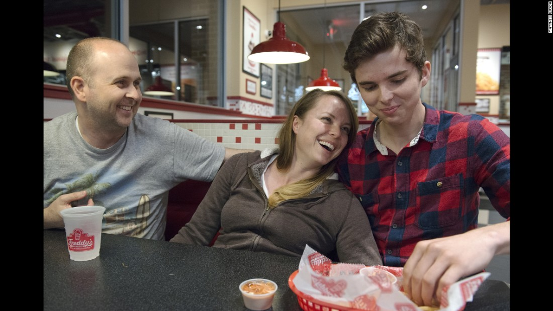 Klein and her husband joke with their son Grant at a local burger joint.