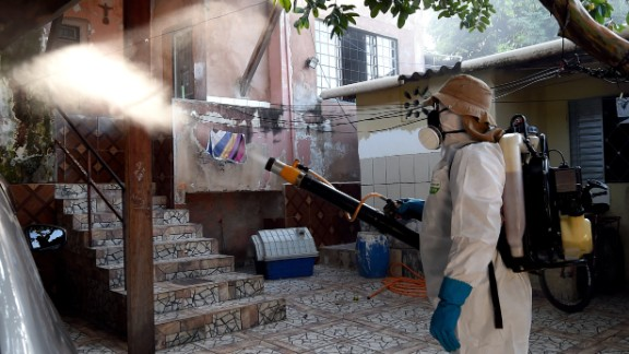 A health worker fumigates an area in Gama, Brazil, to combat the Aedes aegypti mosquito on Wednesday, February 17. The mosquito carries the Zika virus, which has suspected links to birth defects in newborn children. The World Health Organization expects the Zika outbreak to spread to almost every country in the Americas.