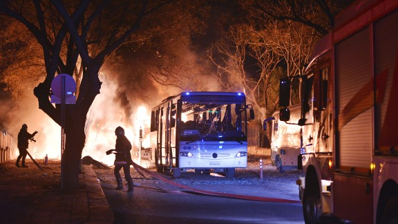 Firefighters work at the scene of a deadly explosion in Ankara, Turkey, on Wednesday, February 17. The explosion hit three military vehicles and a private vehicle near parliament buildings, reported Turkey's semiofficial Anadolu news agency.