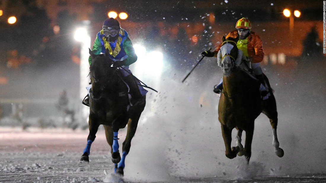 The action doesn't stop when the sun goes down, as White Turf spectators are treated to night-time racing under the lights.