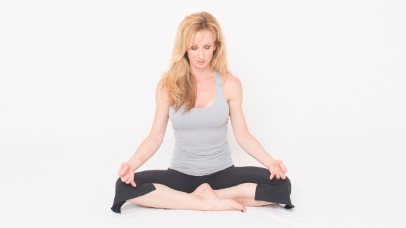 """Dana Santas, creator of <a href=""""http://www.radiusyoga.com/"""" target=""""_blank"""" target=""""_blank"""">Radius Yoga Conditioning</a>, demonstrates a yoga practice to cultivate a mind-body connection. <br /><br />Sit comfortably on the floor or in a chair with your hands resting on your legs. Slightly bow your head and close your eyes. Taking conscious control of your respiration, begin lengthening and deepening your inhalations and exhalations."""