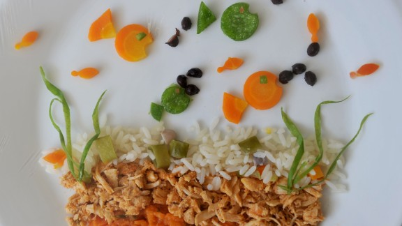 """A decorated plate of food cooked by French chef Roland Villard at the Tim Lopes school in the Complexo do Alemao shantytown in Rio de Janeiro, Brazil on April 25, 2013. The event is part of the launching of the program """"My healthy plate"""" with official and private aiming to teach the young healthy food habits.  AFP PHOTO/TASSO MARCELO        (Photo credit should read TASSO MARCELO/AFP/Getty Images)"""