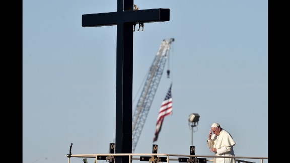Pope Francis prays next to the U.S. border before celebrating Mass in Ciudad Juarez, Mexico, on Wednesday, February 17. The Pope