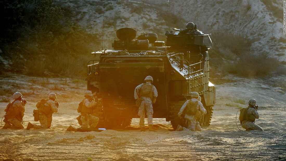 13 Marines charged in case related to human smuggling operations