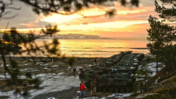 "U.S. Marine Corps amphibious assault vehicles assemble before a public ""splash"" demonstration in the Trondheim Fjord in Norway in January."