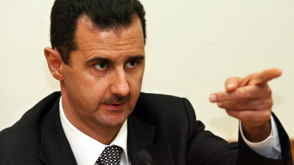 """Moscow, RUSSIAN FEDERATION:  Syrian President Bashar al-Assad speaks during a press conference in Moscow 19 December 2006. Russian President Vladimir Putin and his Syrian counterpart Bashar al-Assad vowed Tuesday to cooperate in efforts to stabilise the Middle East, the Syrian leader saying he was open to dialogue with Washington but not to """"instructions"""". AFP PHOTO / YURI KADOBNOV  (Photo credit should read YURI KADOBNOV/AFP/Getty Images)"""