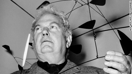 ROME, ITALY:  US painter and sculptor Alexander Calder (1898-1976) displays 13 March 1955 one of his mobiles in a gallery in Rome. Calder first studied mechanical engineering, then art in New York. His first exhibition were held in Paris and Berlin in 1929. His best-known works are the hanging wire mobiles which he began to make in 1934. AFP PHOTO (Photo credit should read AFP/AFP/Getty Images)