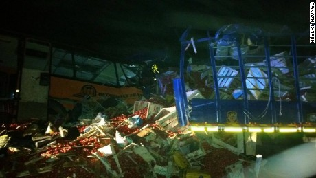 A bus collided with a truck in central Ghana on Wednesday night, killing at least 61 people, police said.