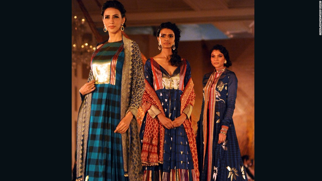 The Benarasi sari is given a modern twist with distinctly Western traits, such  as check prints.