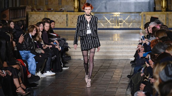 A model walks the runway at the Alexander Wang autumn/winter 2016 fashion show. Wang (no relation to Vera Wang) is a young American designer who favors a black palette and whose lines are stocked in more than 700 stores around the globe.