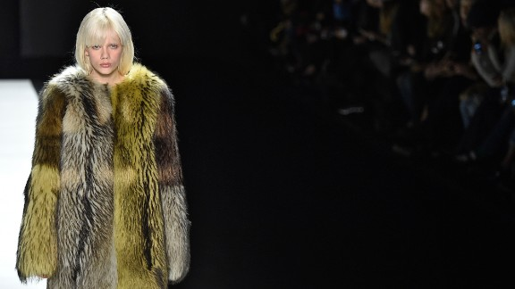 A model shows off a furry coat at the Vera Wang fall/winter 2016 fashion show. Wang's glamorous evening wear has been worn by everyone from Sandra Bullock to Michelle Obama.