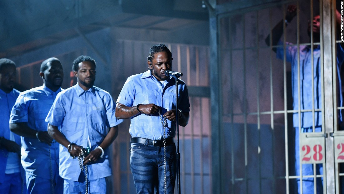 "Rapper Kendrick Lamar performs during the Grammy Awards on Monday, February 15. <a href=""http://www.cnn.com/2016/02/16/entertainment/kendrick-lamar-grammy-performance-feat/index.html"" target=""_blank"">His politically charged performance</a> evoked the chains of slavery and incarceration."