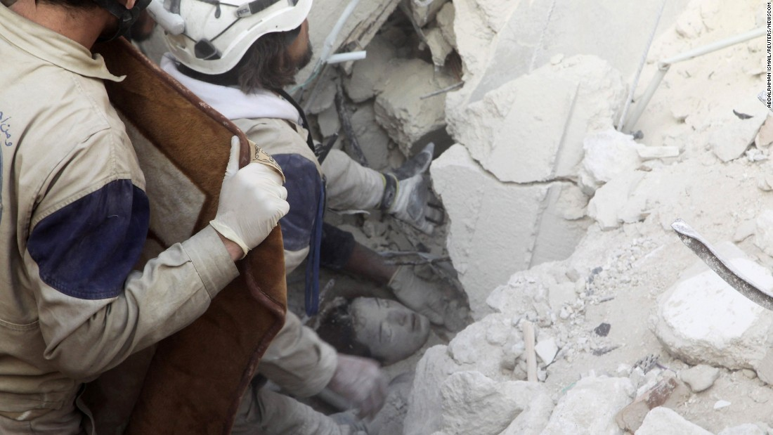 Workers rescue a girl from the rubble after airstrikes hit a rebel-held neighborhood of Aleppo, Syria, on Sunday, February 14.