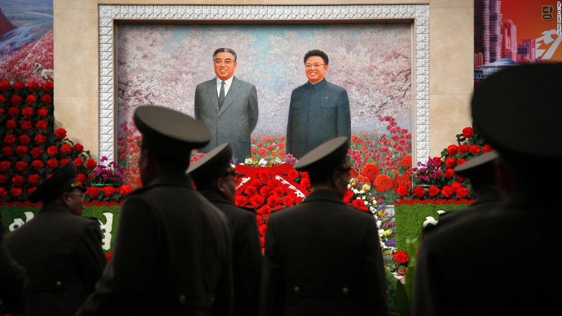 Military soldiers in Pyongyang, North Korea, walk past a mural of the late North Korean leaders Kim Il Sung and Kim Jong Il on Monday, February 15. The country was marking the birthday of Kim Jong Il, who would have been 74 on February 16.