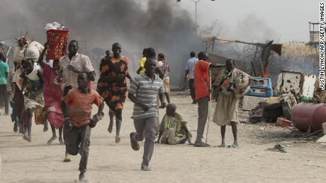People flee violence that erupted at a United Nations base that houses more than 40,000 displaced people in Malakal, South Sudan.