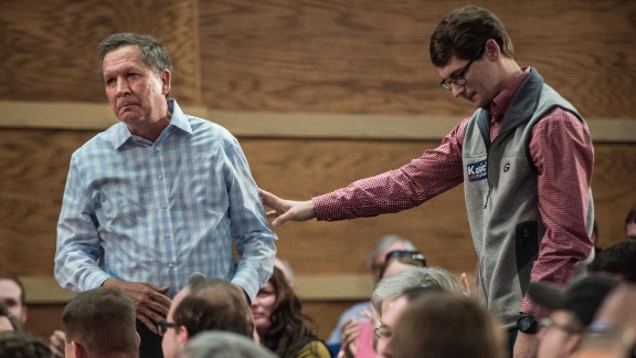 CLEMSON, SC - FEBRUARY 18: University of Georgia student Brett Smith (R) reaches out to Republican presidential candidate John Kasich after sharing a story about suicide at a town hall meeting at Clemson University February 18, 2016 in Clemson, South Carolina. The South Carolina Republican primary will be held Saturday, February 20. (Photo by Sean Rayford/Getty Images)