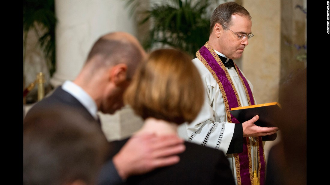 Scalia's son Paul, a Catholic priest, leads a prayer for his father during the private ceremony at the Supreme Court.