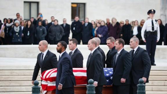 Pallbearers carry Scalia's casket on February 19.
