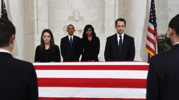 U.S. President Barack Obama and first lady Michelle Obama pay their respects as the body of Supreme Court Justice Antonin Scalia lies in repose on Friday, February 19.