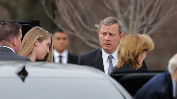 Chief Justice John Roberts, his wife, Jane Roberts, and daughter Josie Roberts arrive for the funeral on February 20.