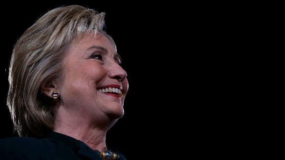 """Democratic presidential candidate former Secretary of State Hillary Clinton looks on during a """"Get Out The Caucus"""" event at the Clark County Government Center on February 19, 2016 in Las Vegas, Nevada."""