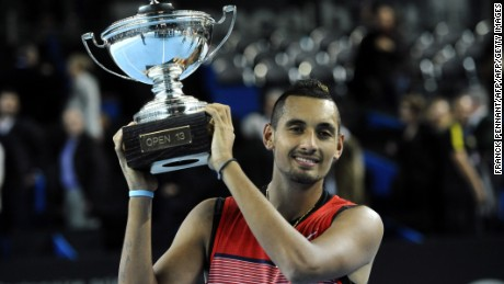 Australia's Nick Kyrgios poses with the trophy after winning the ATP Marseille Open 13 tournament with a straight sets win over Marin Cilic of Croatia.