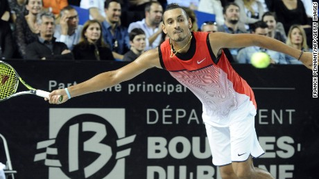 Krygios at full stretch during his straights sets win over Cilic to claim his first ATP title.