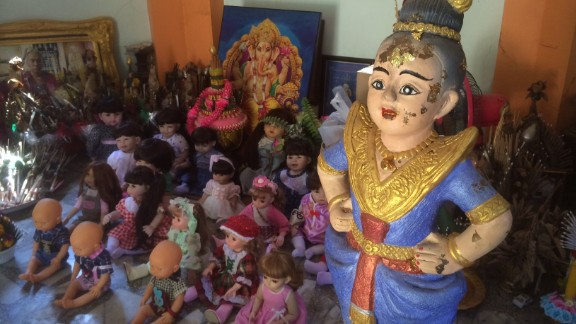 Many dolls have been brought here to the temple, where they can be shown due respect.
