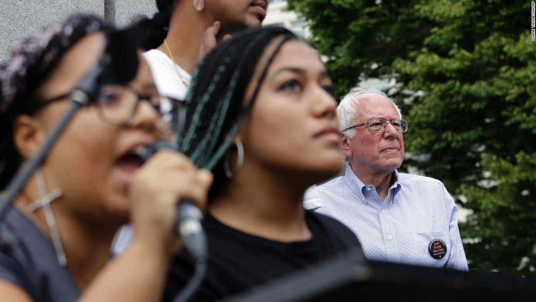 "Seconds after Sanders took the stage for a campaign rally in August 2015, a dozen protesters from Seattle's Black Lives Matter chapter <a href=""http://www.cnn.com/2015/08/08/politics/bernie-sanders-black-lives-matter-protesters/index.html"" target=""_blank"">jumped barricades and grabbed the microphone</a> from the senator. Holding a banner that said ""Smash Racism,"" two of the protesters -- Marissa Johnson, left, and Mara Jacqueline Willaford -- began to address the crowd."