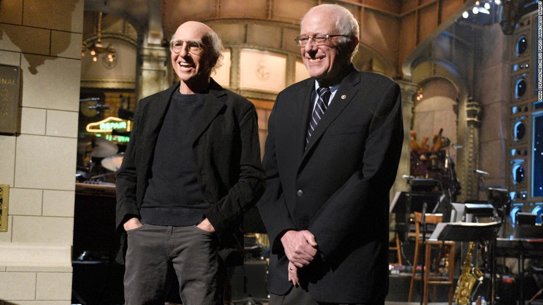 "Comedian Larry David and Sanders <a href=""http://money.cnn.com/2016/02/07/media/bernie-sanders-larry-david-saturday-night-lvie/"" target=""_blank"">appear together on ""Saturday Night Live""</a> in February 2016. David had played Sanders in a series of sketches throughout the campaign season."
