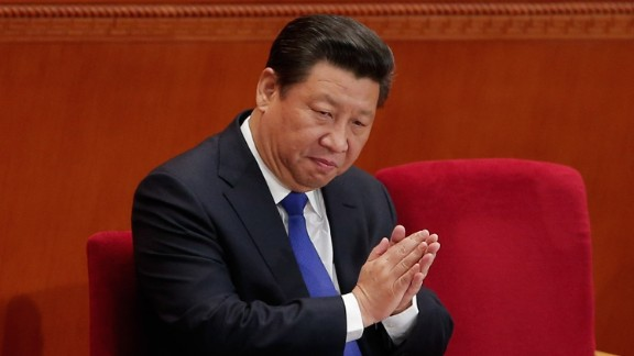 BEIJING, CHINA - MARCH 05:  Chinese President Xi Jinping applauds during the opening of the 3rd Session of the 12th National People's Congress at the Great Hall of the People on March 5, 2015 in Beijing, China. The government work report presented:  the main targets of economic and social development; a projected 2015 GDP growth of about 7 percent; and consumer prices rising about 3 percent.  (Photo by Lintao Zhang/Getty Images)