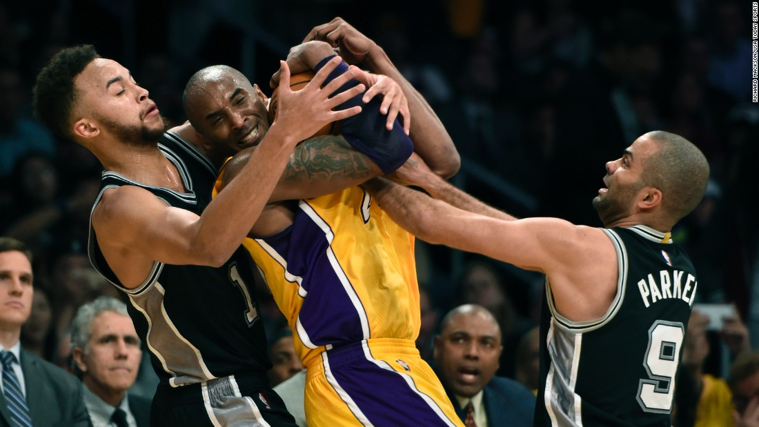 Kobe Bryant is swarmed by San Antonio's Kyle Anderson and Tony Parker during an NBA game in Los Angeles on Friday, February 19.