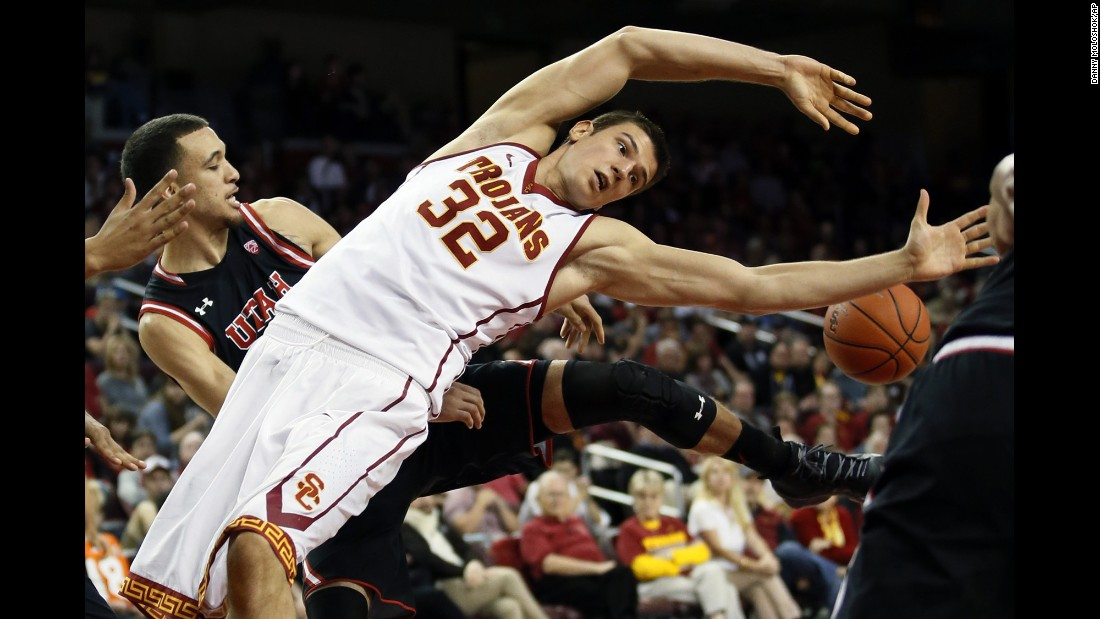 USC's Nikola Jovanovic loses the ball after his shot was blocked by Utah's Brekkott Chapman, left, on Sunday, February 21.